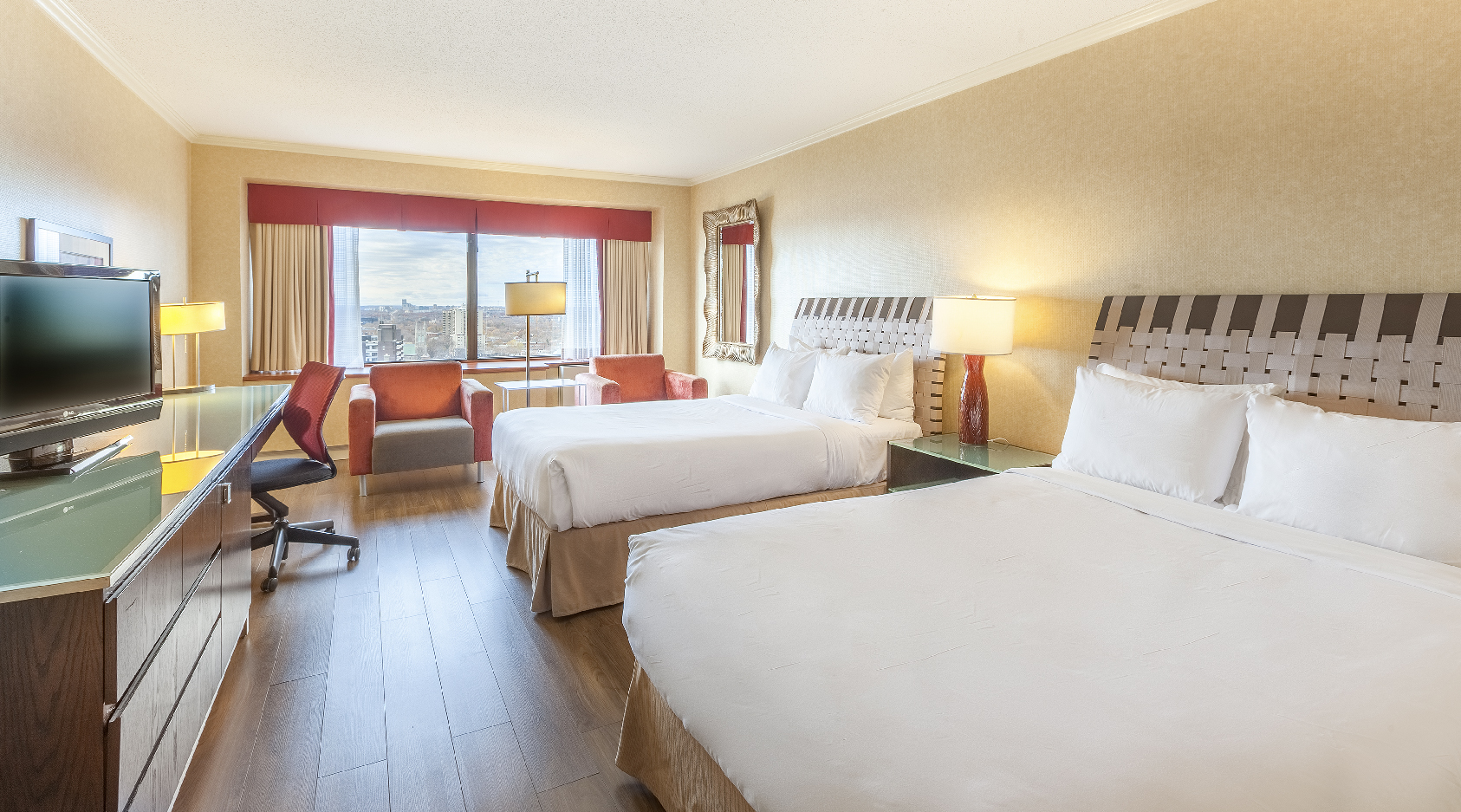 Room with 2 Double Beds of Hotel Le Concorde Quebec
